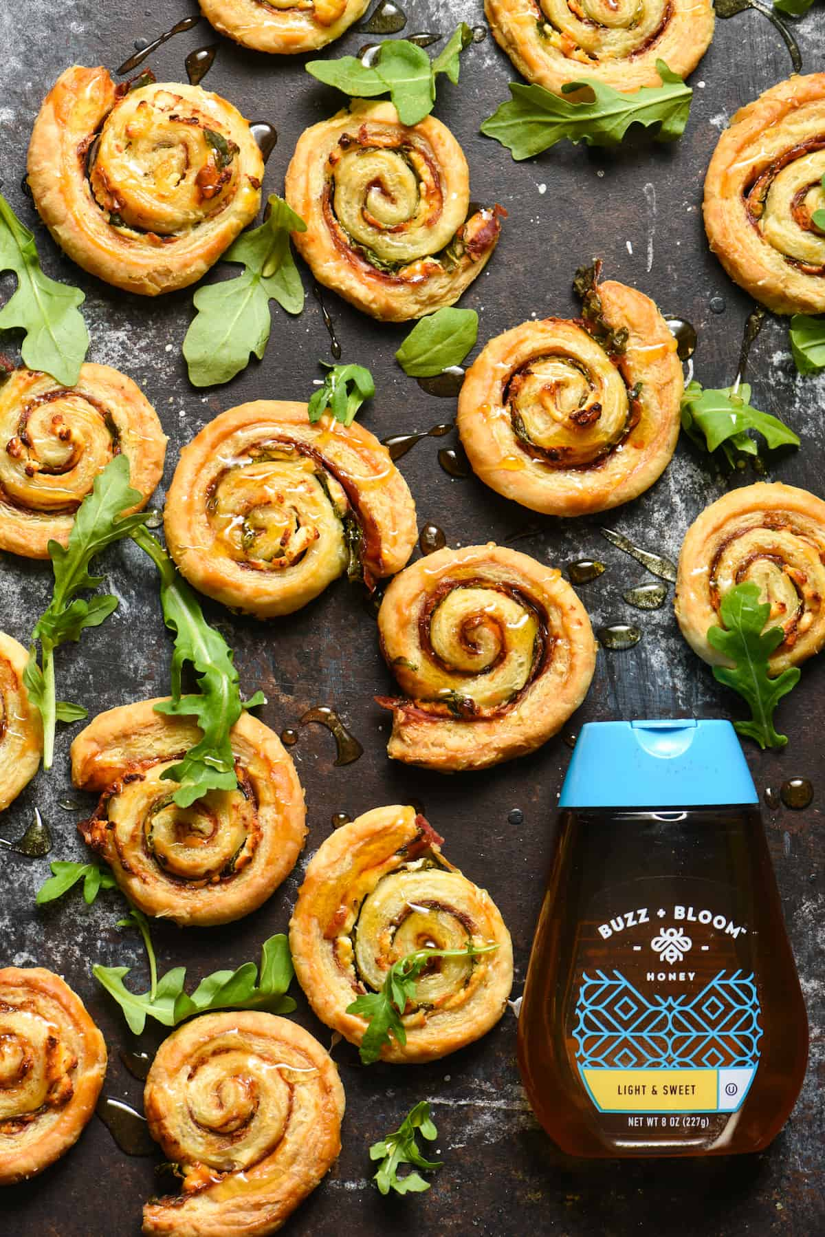 Salami & Goat Cheese Pinwheels with Honey - These easy appetizer bites are the perfect combination of savory, sweet, cheesy and crunchy! | foxeslovelemons.com