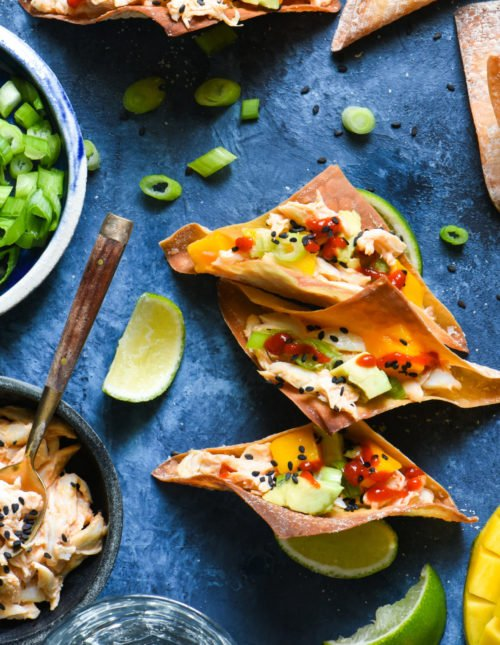Spicy Crab Wonton Tacos - The flavors of a California sushi roll, in a crunchy wonton taco. Impress your guests with these easy entertaining recipe.   foxeslovelemons.com