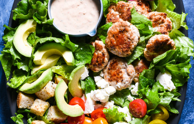 Deluxe Turkey Burger Salad - A jazzed-up version of a bunless burger, with creamy Sun Dried Tomato Dressing. | foxeslovelemons.com