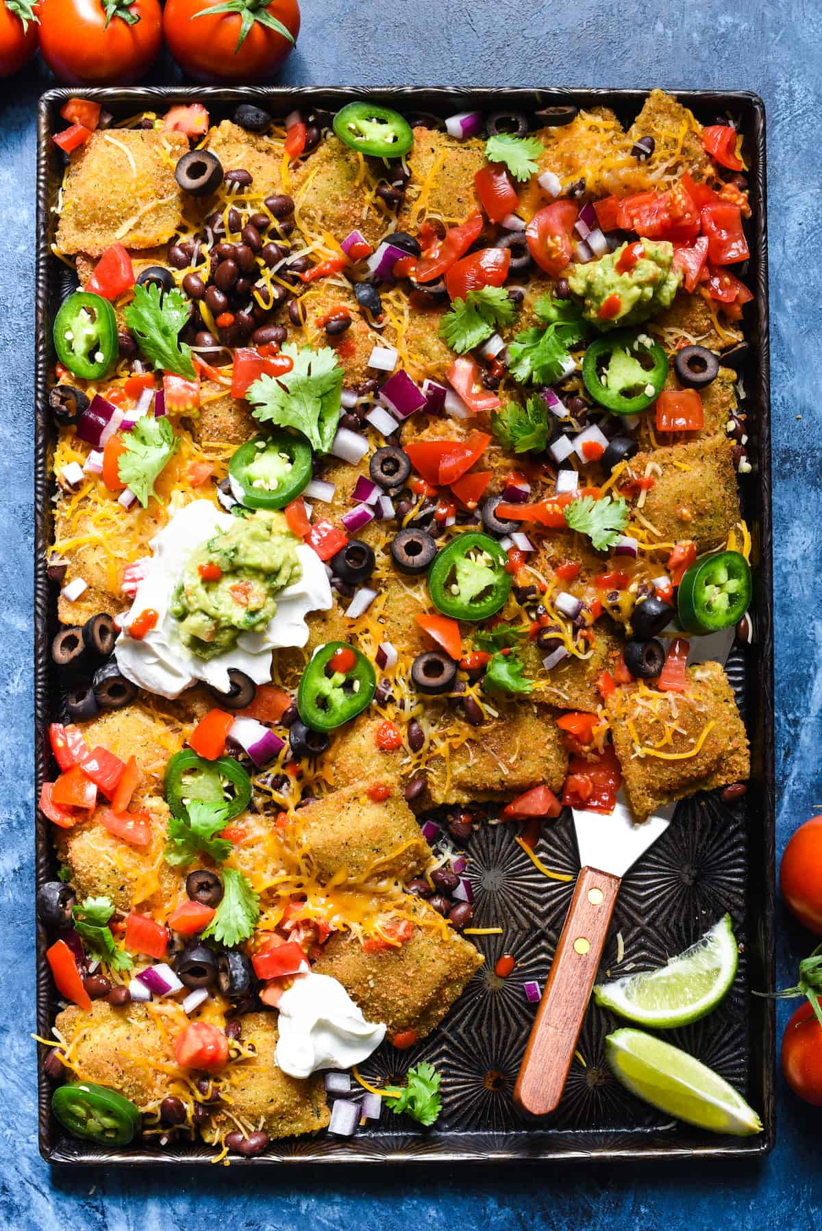 "Toasted Ravioli Nachos AKA ""Ravilachos"" - Use toasted beef ravioli in place of tortilla chips for this crowd-pleasing take on nachos! | foxeslovelemons.com"