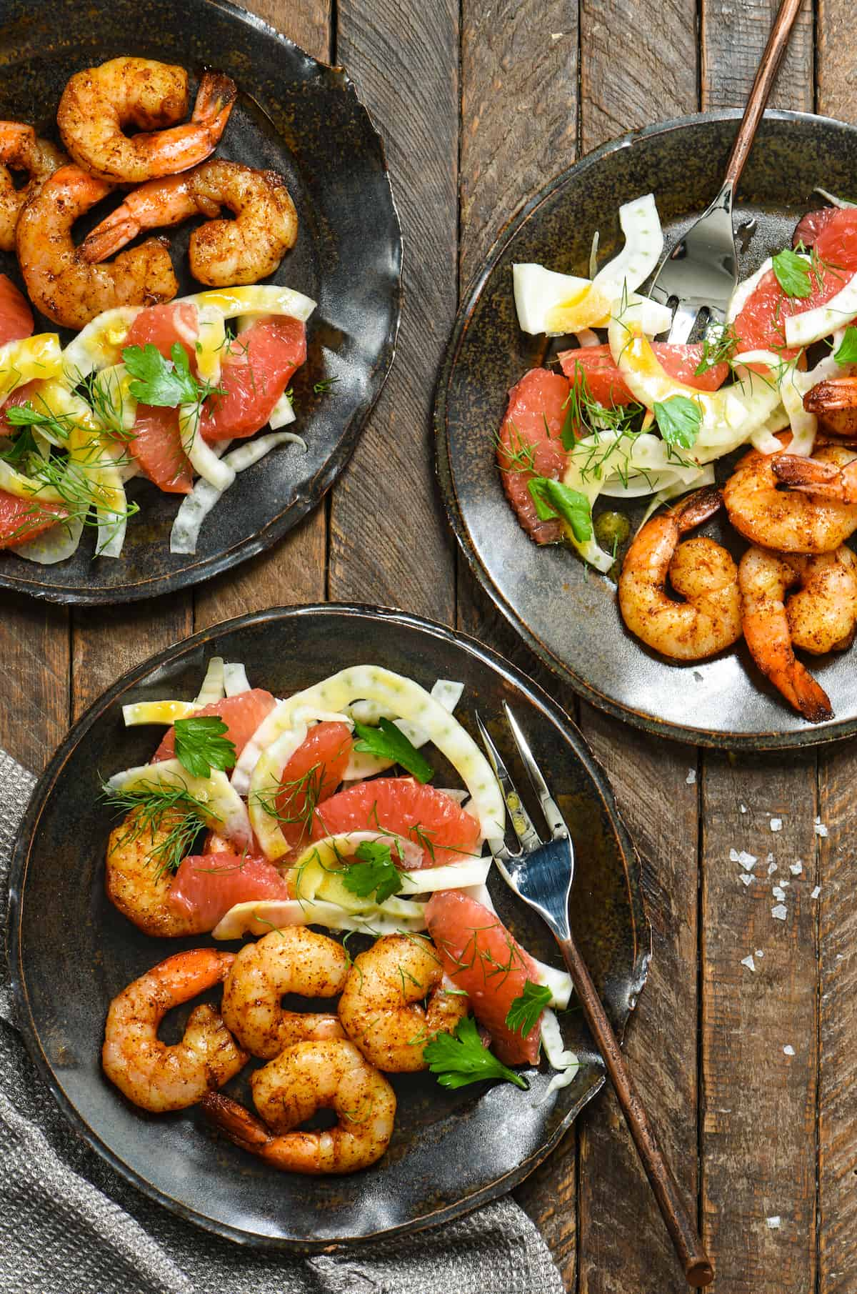 Roasted Shrimp with Grapefruit & Fennel Salad + 11 Grapefruit Recipes to Brighten Your Winter - Bring some happy flavor to a cold day with an appetizer, cocktail, breakfast, salad, lunch or dinner celebrating juicy, sweet grapefruit! | foxeslovelemons.com