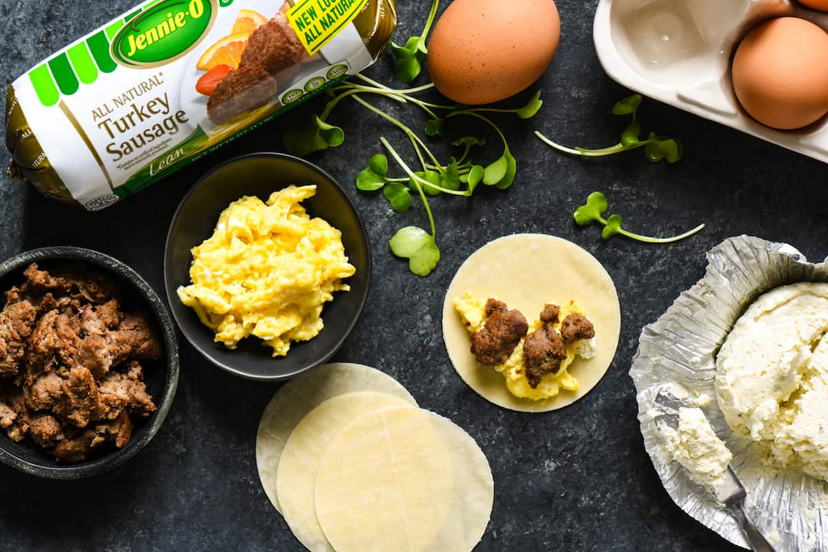 Lazy Sunday Breakfast Dumplings - Make brunch fun again with these sausage, egg and cheese wontons served with two easy dipping sauces.   foxeslovelemons.com