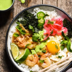 Funky Good Rice & Shrimp Bowls - Shake up your weeknight dinner routine with a rice bowl loaded with shrimp, pickled veggies and a fried egg, and topped with an easy homemade green chili sauce. | foxeslovelemons.com