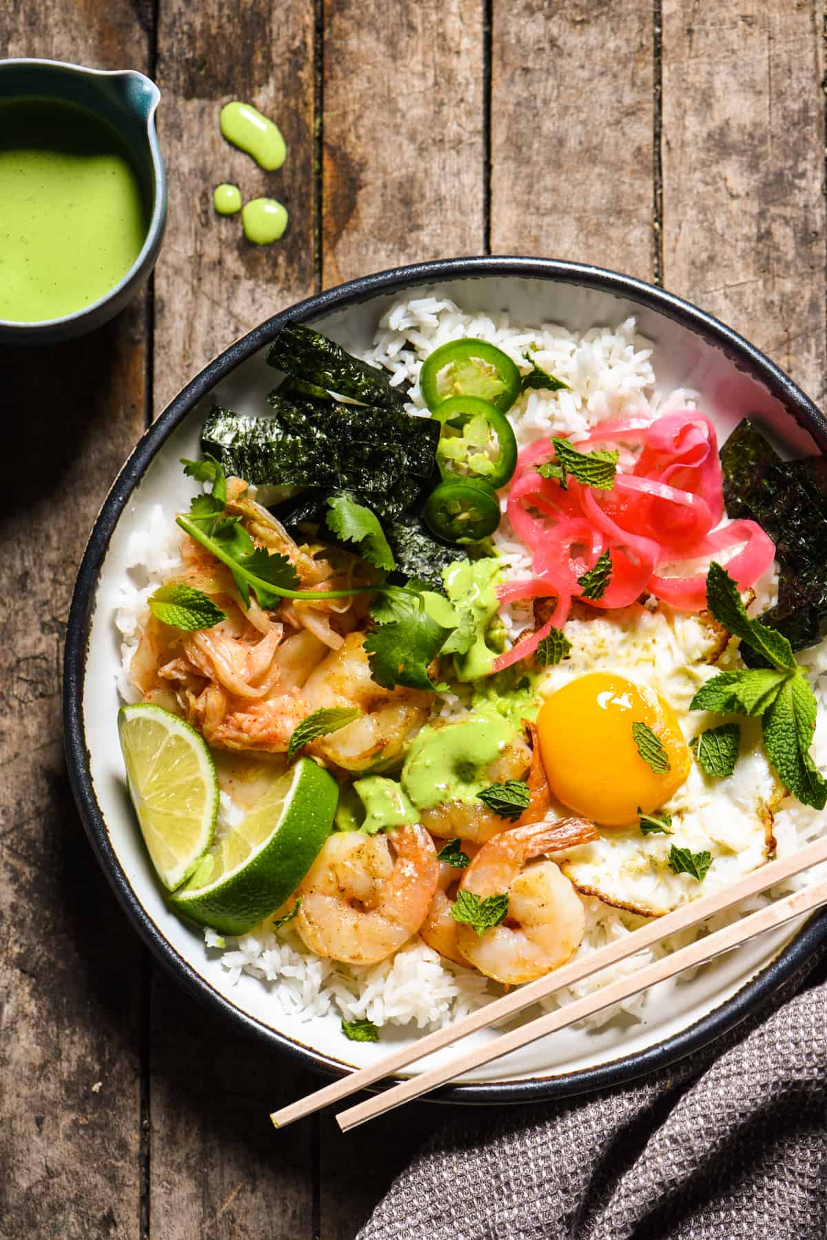 Funky Good Rice & Shrimp Bowls - Shake up your weeknight dinner routine with a rice bowl loaded with shrimp, pickled veggies and a fried egg, and topped with an easy homemade green chili sauce.   foxeslovelemons.com