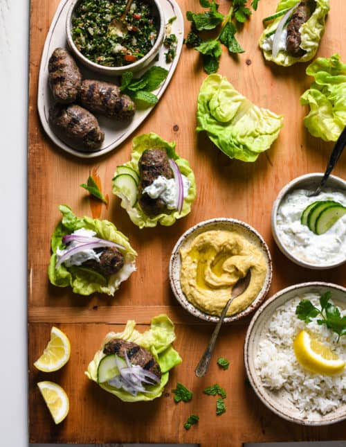Grilled Kafta Lettuce Wraps - Spiced lamb and beef patties are wrapped in cooling butter lettuce leaves for a fresh and flavorful meal you'll want to serve every week! | foxeslovelemons.com
