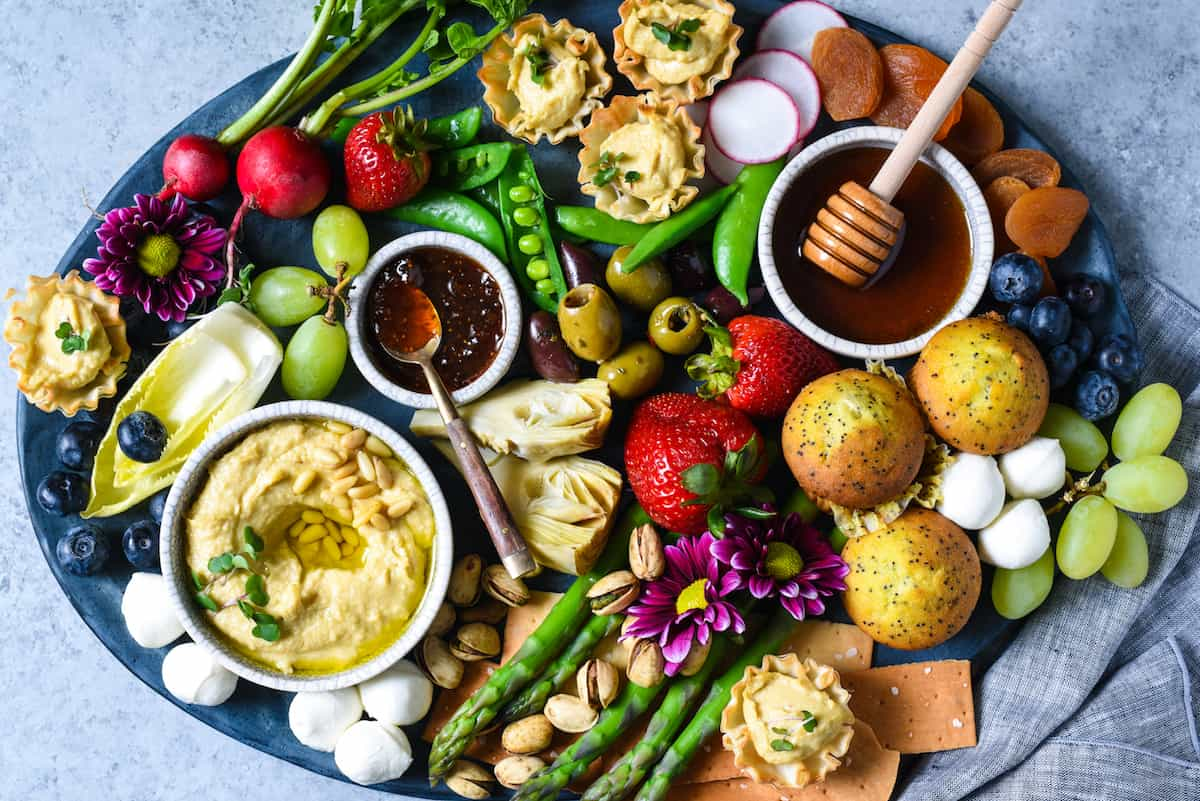 Spring Snack Platter with Hummus Phyllo Bites - A fresh, satisfying unofficial meal filled with seasonal produce and fun goodies. | foxeslovelemons.com