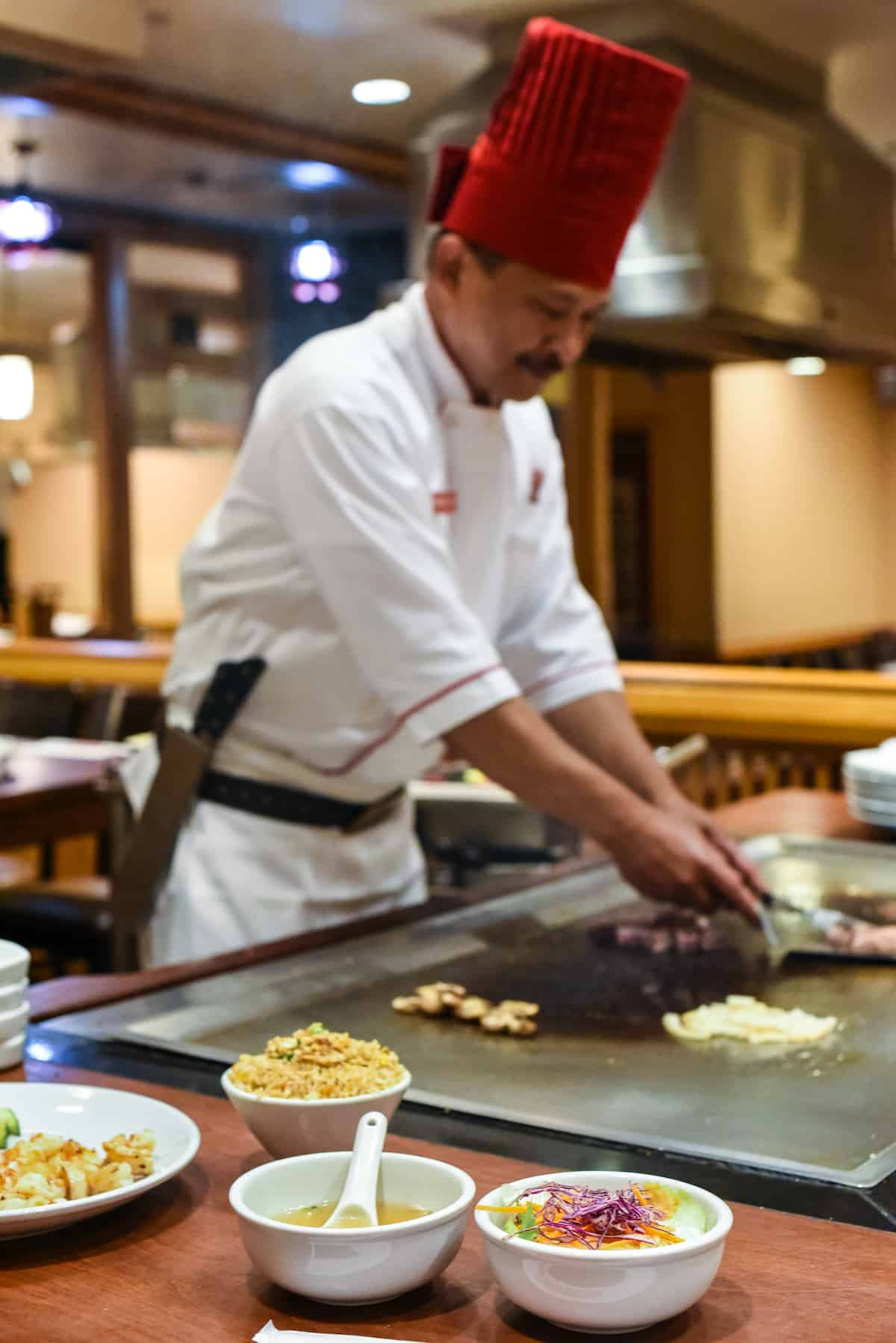 "Learning the Art of Teppanyaki - Wow your friends with Benihana's ""Be The Chef"" program by learning how to cook on a teppan grill, and enjoy a meal of steak, shrimp and fried rice. 