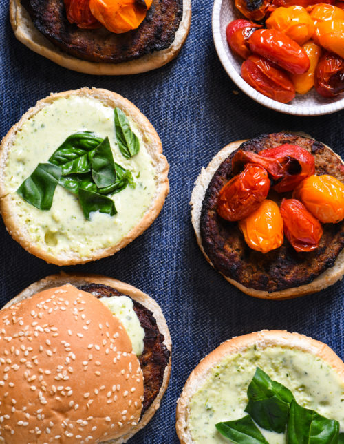"Grill-Roasted Tomato Turkey Burgers with Pesto Ranch - Spruce up burger night with homemade pesto ranch dressing, and tomatoes that are ""roasted"" on the grill in a foil packet. 