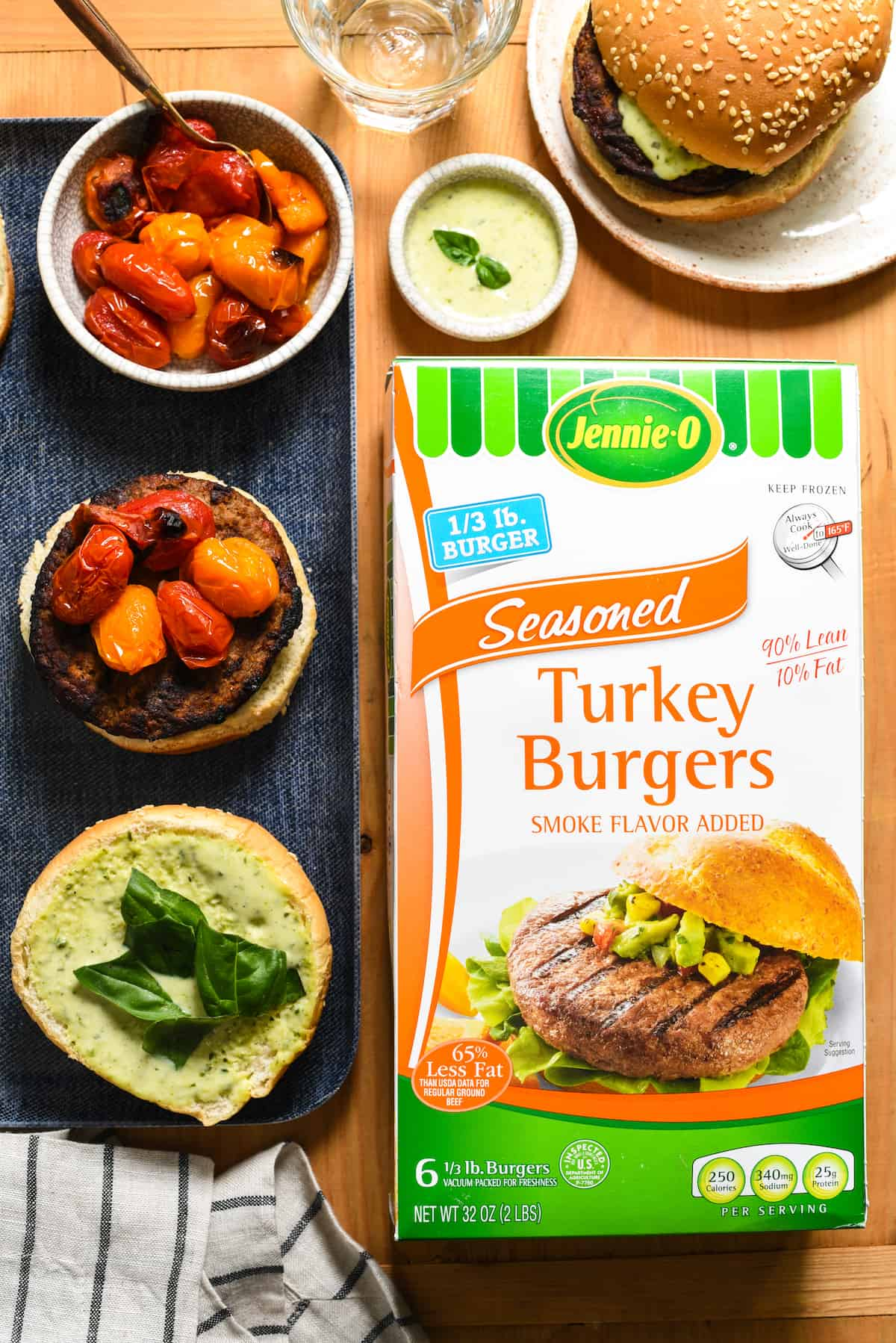 """Grill-Roasted Tomato Turkey Burgers with Pesto Ranch - Spruce up burger night with homemade pesto ranch dressing, and tomatoes that are """"roasted"""" on the grill in a foil packet. 