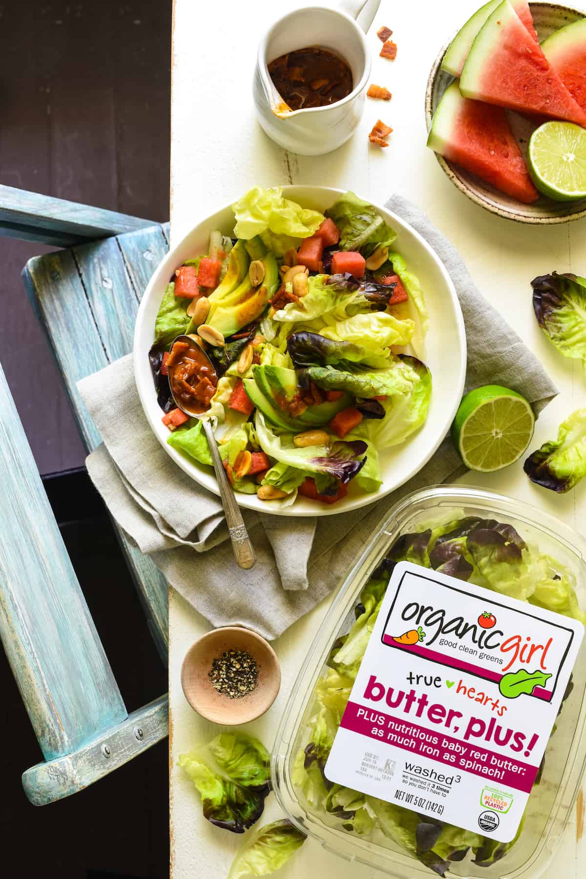 Watermelon and Avocado Salad with Warm Bacon Dressing - An irresistible sweet and savory summer salad! Butter lettuce, watermelon, avocado and peanuts are topped with an easy warm bacon dressing.   foxeslovelemons.com