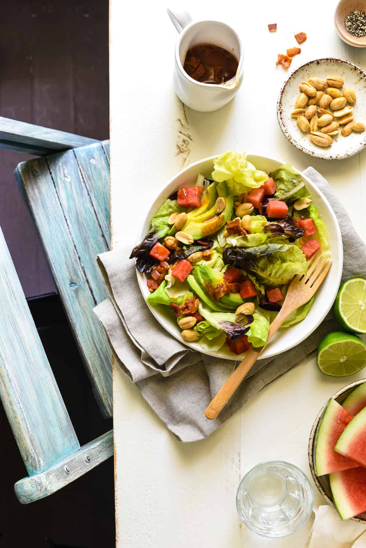 Watermelon and Avocado Salad with Warm Bacon Dressing - An irresistible sweet and savory summer salad! Butter lettuce, watermelon, avocado and peanuts are topped with an easy warm bacon dressing. | foxeslovelemons.com