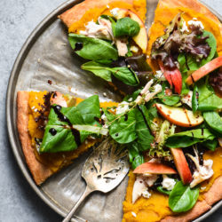 "This Fall Harvest Salad Pizza celebrates all the best fresh autumn produce. Use a roasted butternut squash and maple syrup purée as the ""sauce"" and top with a heaping helping of salad with chicken, cheese and apples! 