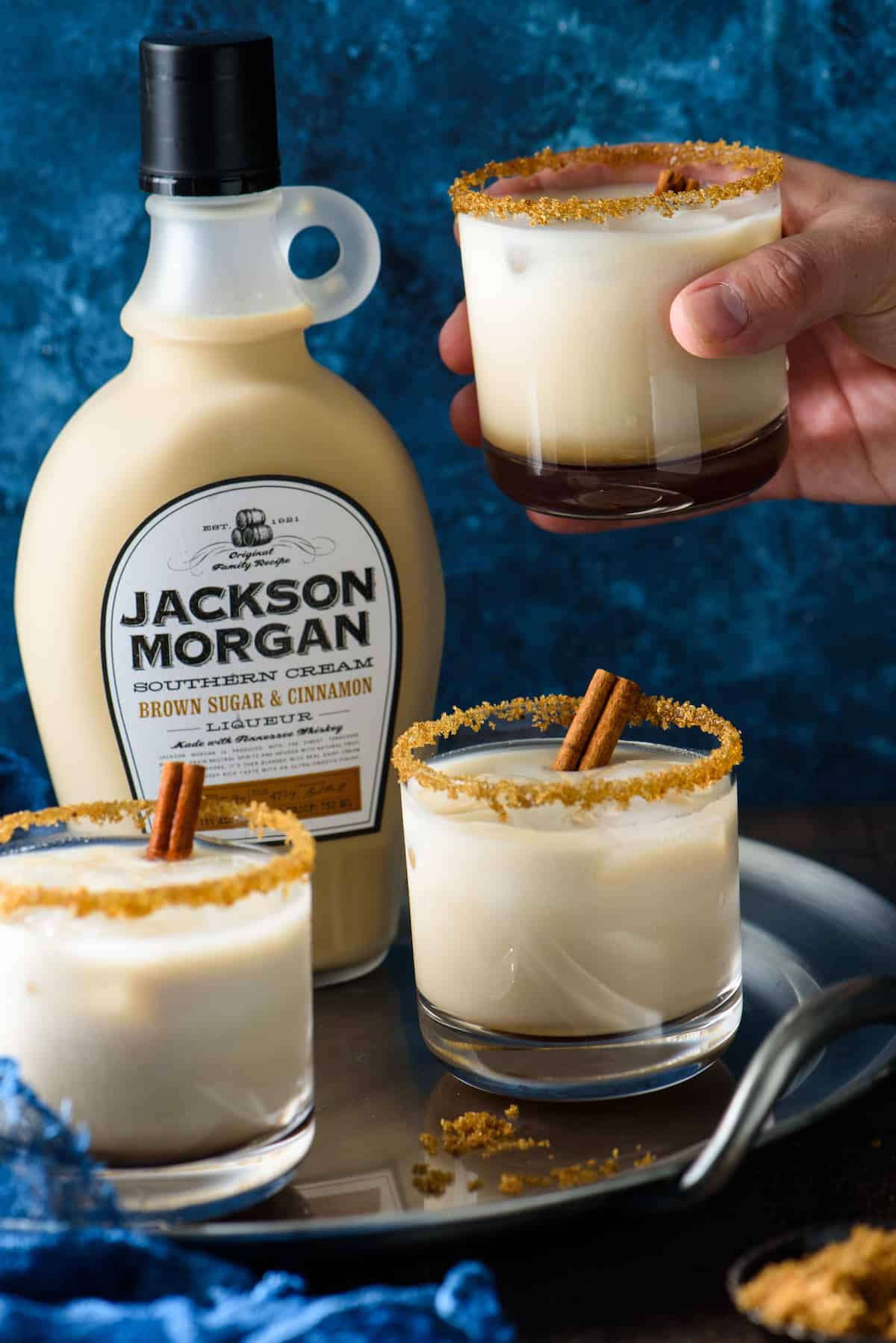 This Brown Sugar & Cinnamon White Russian is creamy and comforting. The combo of coffee liqueur, brown sugar and cinnamon southern cream, vodka and milk feels like a cocktail and dessert, all in one glass!   foxeslovelemons.com