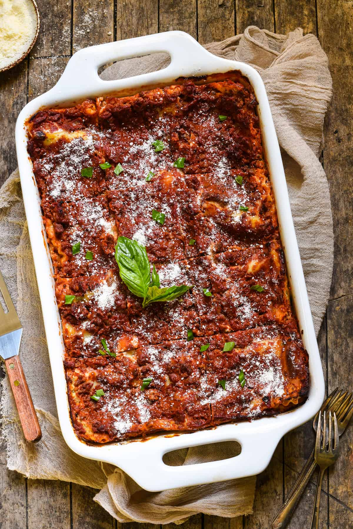 Mom's Lasagna with Cottage Cheese - A classic Midwestern noodle casserole. Layers of rich meat sauce, pasta, creamy filling and cheese will have the whole family coming back for seconds! | foxeslovelemons.com