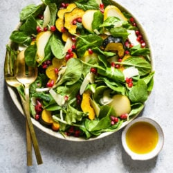 Really Good Thanksgiving Salad - If you believe that every Thanksgiving menu needs a bright and fresh salad, this recipe is for you! Greens, Parmesan cheese and the best harvest produce is tossed with a simple maple vinaigrette. | foxeslovelemons.com