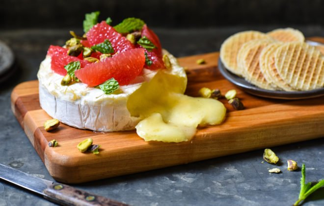 With just 4 ingredients and a 10 minute prep time, this Easy Baked Brie with Grapefruit & Pistachios is ideal for a party, or just a delicious snack at home. | foxeslovelemons.com