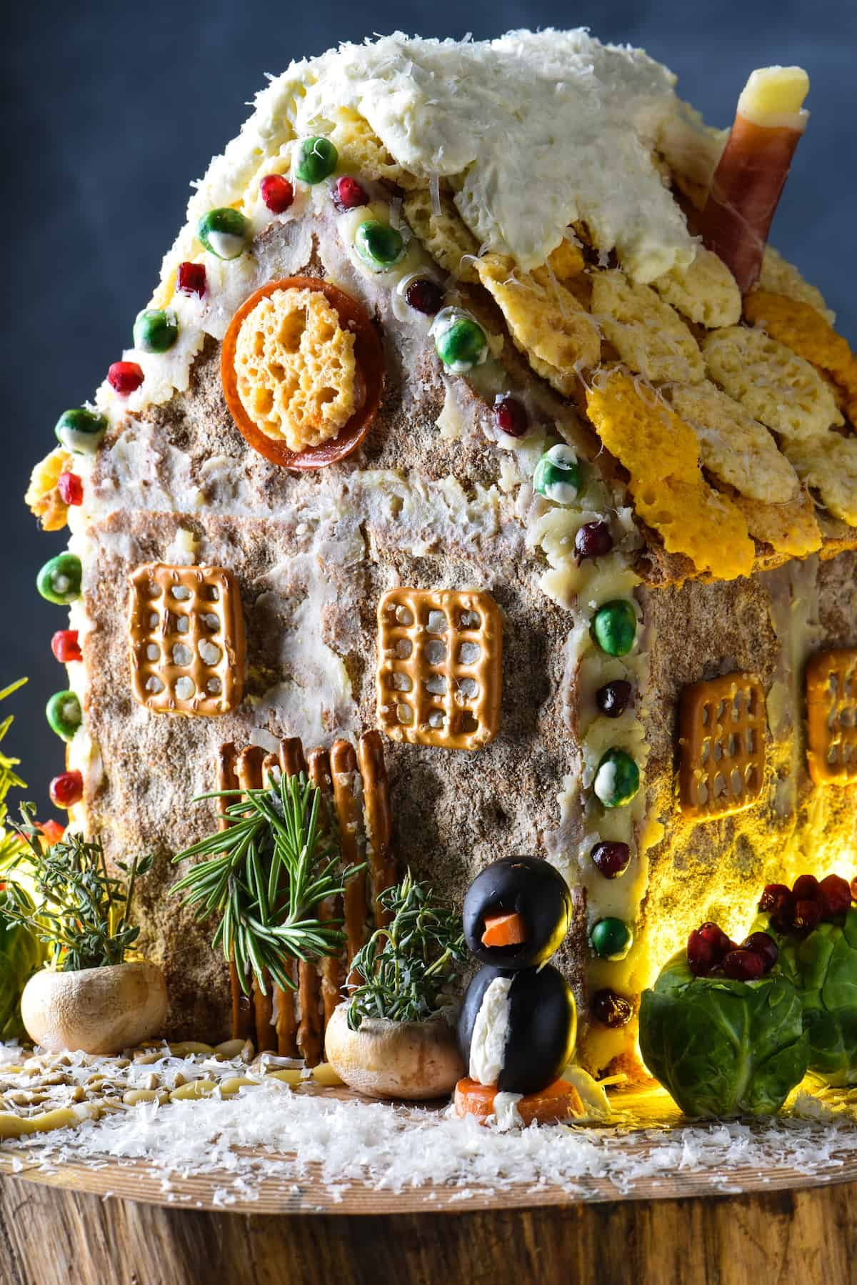 Shake up tradition this holiday season with this Holiday Cheese & Cracker House, which is like a savory gingerbread house. Get creative with things like cheese, crackers, pretzels, herbs and veggies!