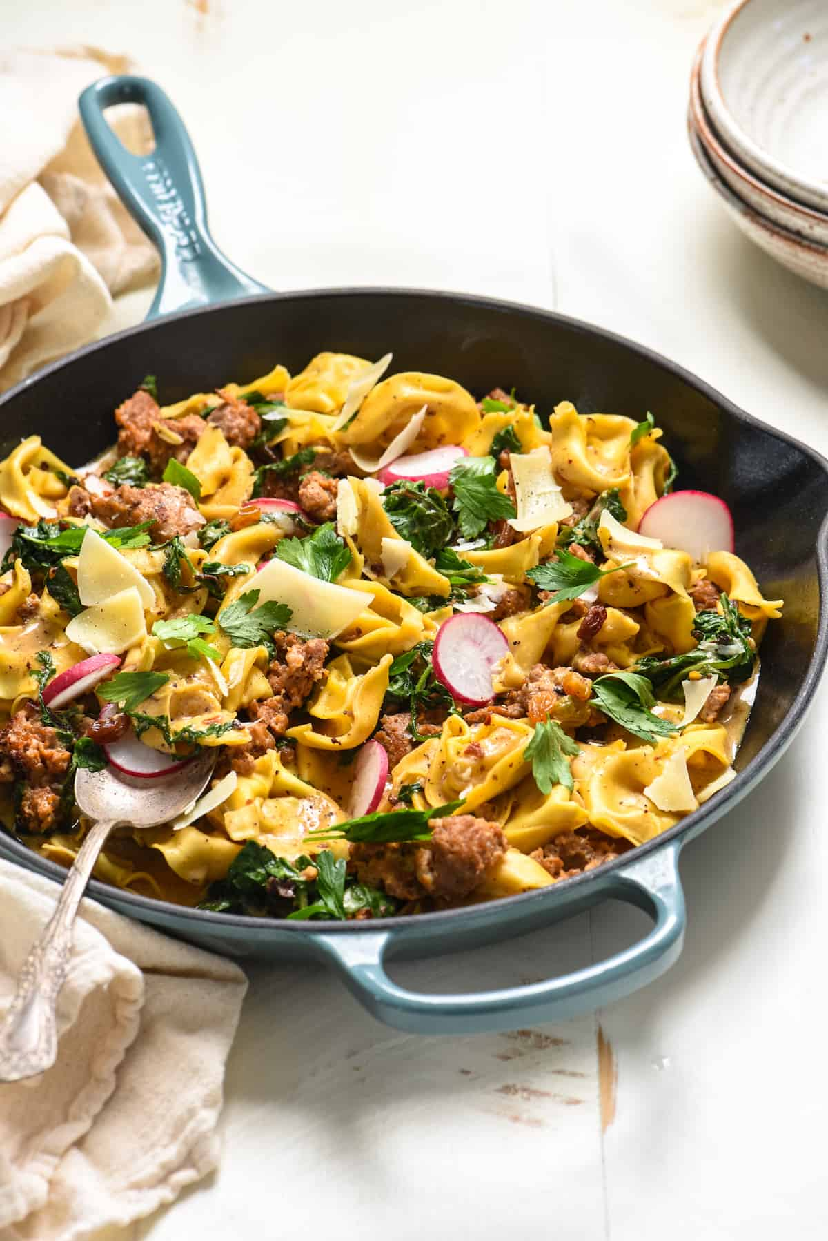 This One Pan Sausage & Tortellini can be on the table in minimal time with minimal dishes. It's a perfect balance of creamy, spicy and sweet, and there's tons of hidden veggies, too!  | foxeslovelemons.com