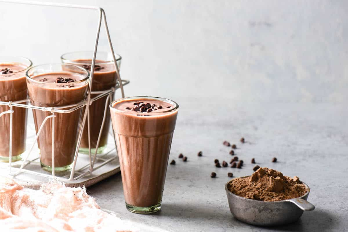 Blend up this High Protein Cocoa Smoothie for an energizing breakfast, or recovery after a workout. Fruity and full of chocolate flavor, it feels decadent while still being good for you! | foxeslovelemons.com