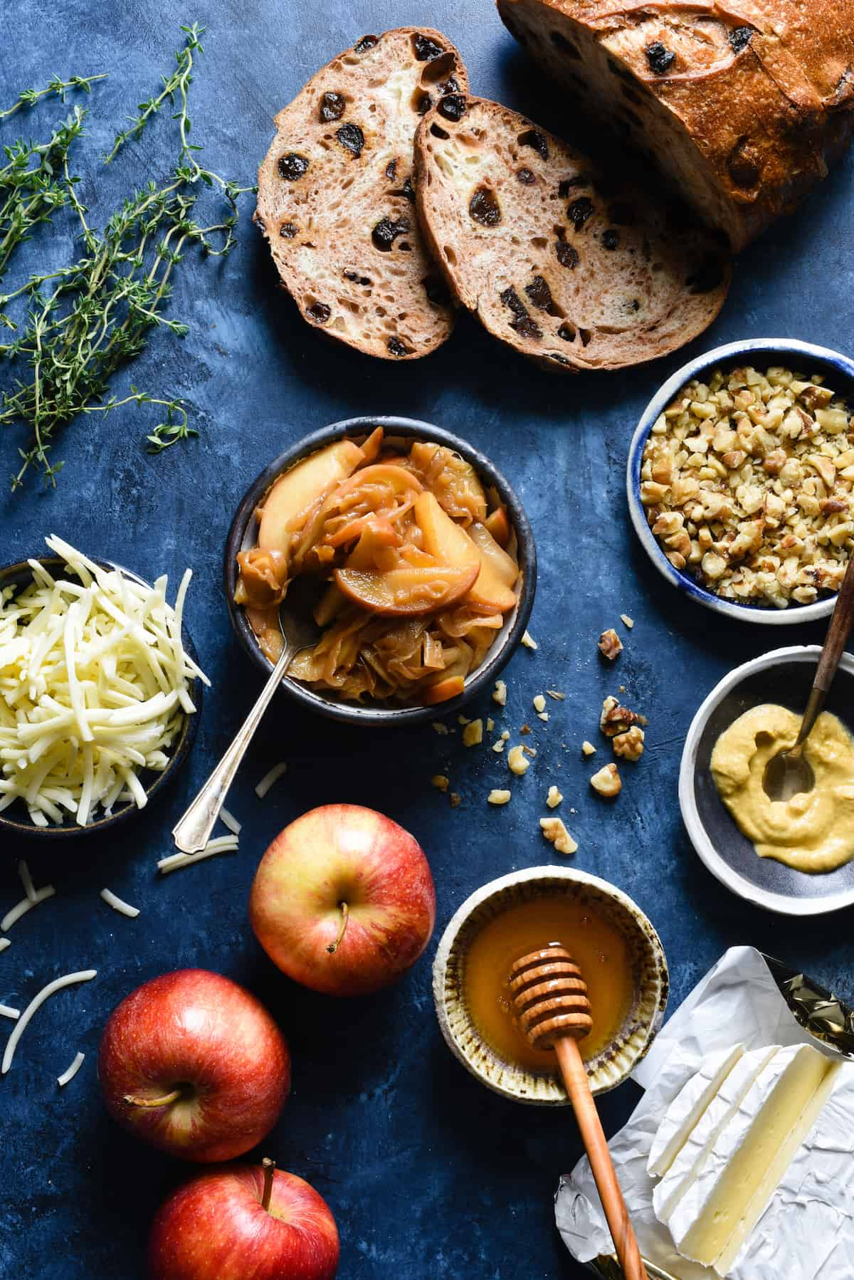 This Apple Grilled Cheese is an irresistible combination of sautéed apples, sweet caramelized onions, brie and white cheddar cheeses, Dijon mustard and walnuts. It's the best toasted sandwich you've ever made at home!   foxeslovelemons.com