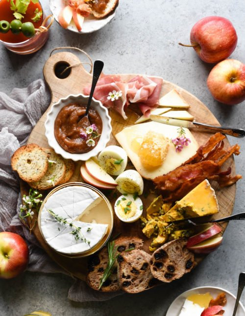 Enjoy a European-style breakfast for a change with this Breakfast Cheese Board. A perfect combination of sweet and savory, there's something for everybody, including easy homemade apple butter.| foxeslovelemons.com