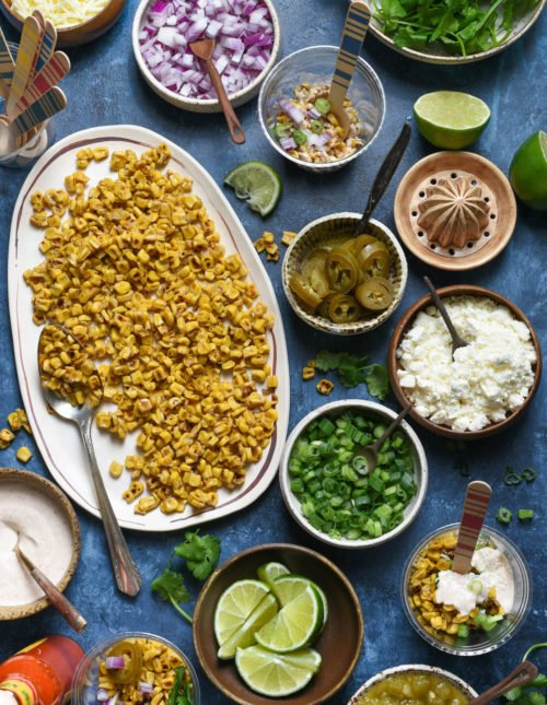 Having a fiesta? Please the whole crowd with thisMexican Street Corn Salad Bar. Gather all of the ingredients for classic Mexican street corn (elote), but let everybody assemble their own. Perfect for the spice lovers, the picky eaters, and the cilantro-adverse! | foxeslovelemons.com
