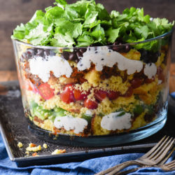 Having a backyard barbecue or going to a potluck?This Layered Southwestern Cornbread Salad can be made in advance and served cold. With the layers of colors and flavors, it's certain to stand out on the buffet table. | foxeslovelemons.com