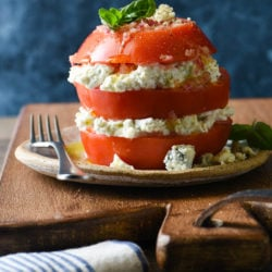 Take fresh summer tomatoes to the next level with this Tomato & Blue Cheese Salad Stack. Juicy sliced tomatoes are layered with creamy blue cheese spread and then drizzled with homemade shallot vinaigrette. | foxeslovelemons.com
