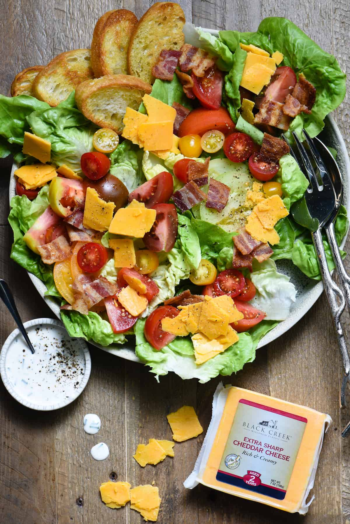 Turn a classic summer sandwich into a dinner-worthy salad with this BLT Salad with Aged Cheddar. Drizzle with easy homemade buttermilk-chive dressing! | foxeslovelemons.com