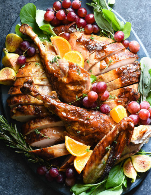 This Maple Bourbon Glazed Turkey is so simple yet so beautiful! It's perfect for all home chefs, from Thanksgiving novices to seasoned pros. | foxeslovelemons.com