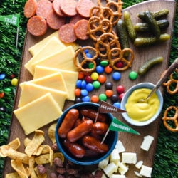 Keep your football parties delicious this fall with a platter piled high with sweet and salty snacks. Fans of all ages will enjoy this Tailgate Cheese Board! | foxeslovelemons.com