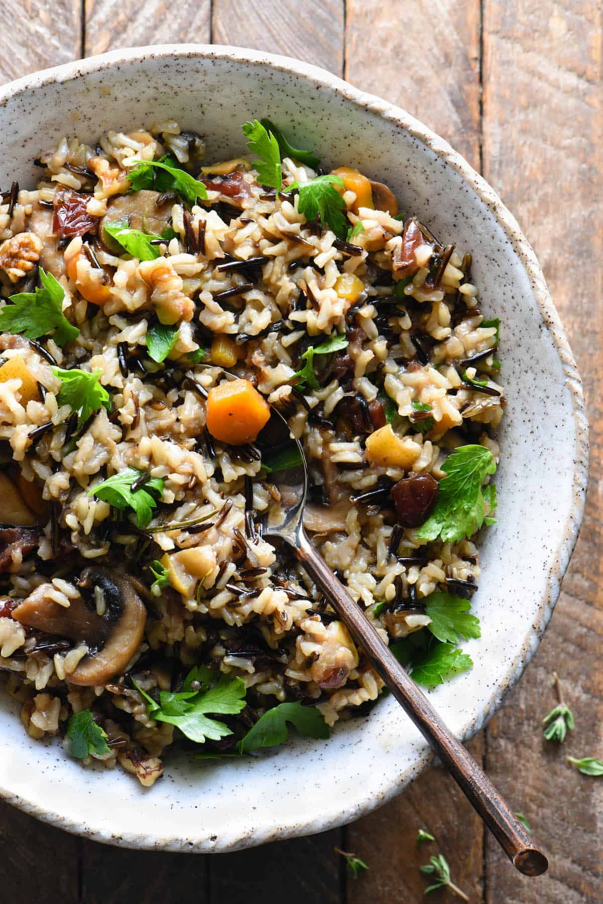 Bring a delicious but unexpected side dish to your table by making this Thanksgiving Rice Pilaf with Cranberries & Pears. This brown rice and wild rice pilaf is packed with fruit, nuts and herbs for the perfect balance of savory and sweet. | foxeslovelemons.com