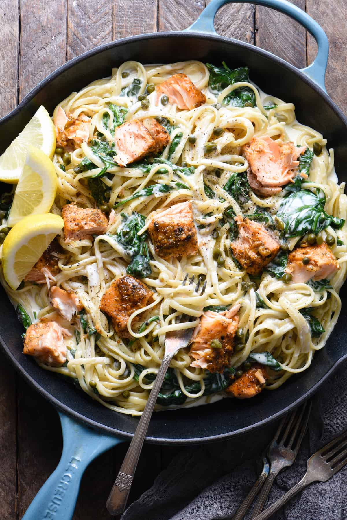 """Show your significant other what a """"home chef"""" you are by impressing them with this Creamy Salmon Pasta with Spinach. The perfect recipe for a date night at home, or just an easy weeknight dinner. 