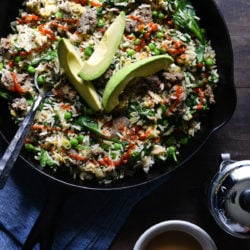 Break out a big cast iron skillet and feed a crowd with this Breakfast Fried Rice. Full of lean turkey sausage, eggs and lots of veggies, this will keep the crew fueled all morning. | foxeslovelemons.com