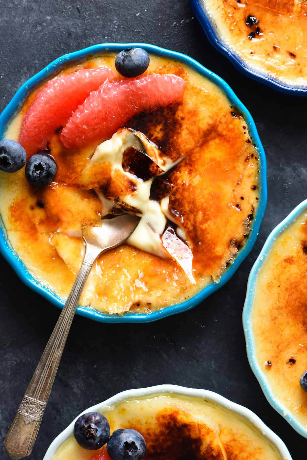 Preparing, torching and serving this Grapefruit Crème Brûlée is bound to make you feel like the kitchen superstar you are. Rich custard is flavored with sweet grapefruit juice and zest for a refreshing twist on a classic dessert. | foxeslovelemons.com