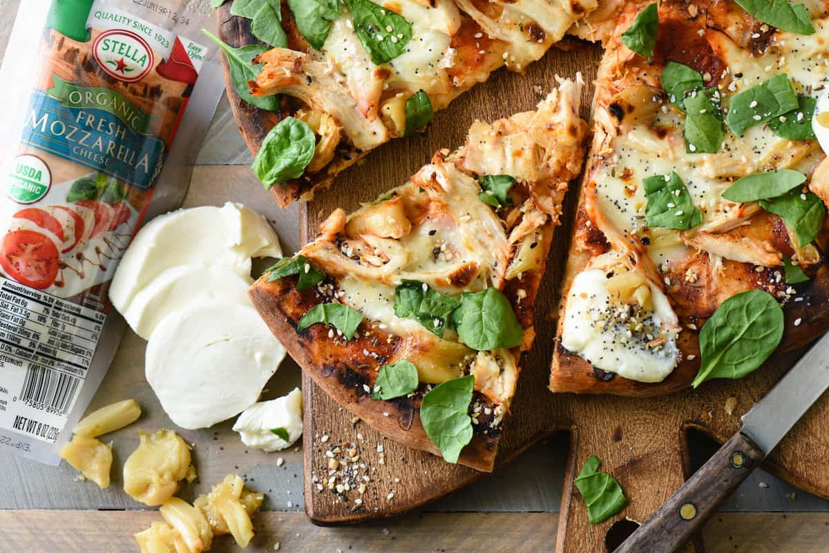If you're making homemade pizza in the summer, you HAVE to try it on the grill! This Grilled Chicken Pizza with Mozzarella & Roasted Garlic recipe provides step-by-step instructions that will teach you how to grill pizza like a pro.   foxeslovelemons.com