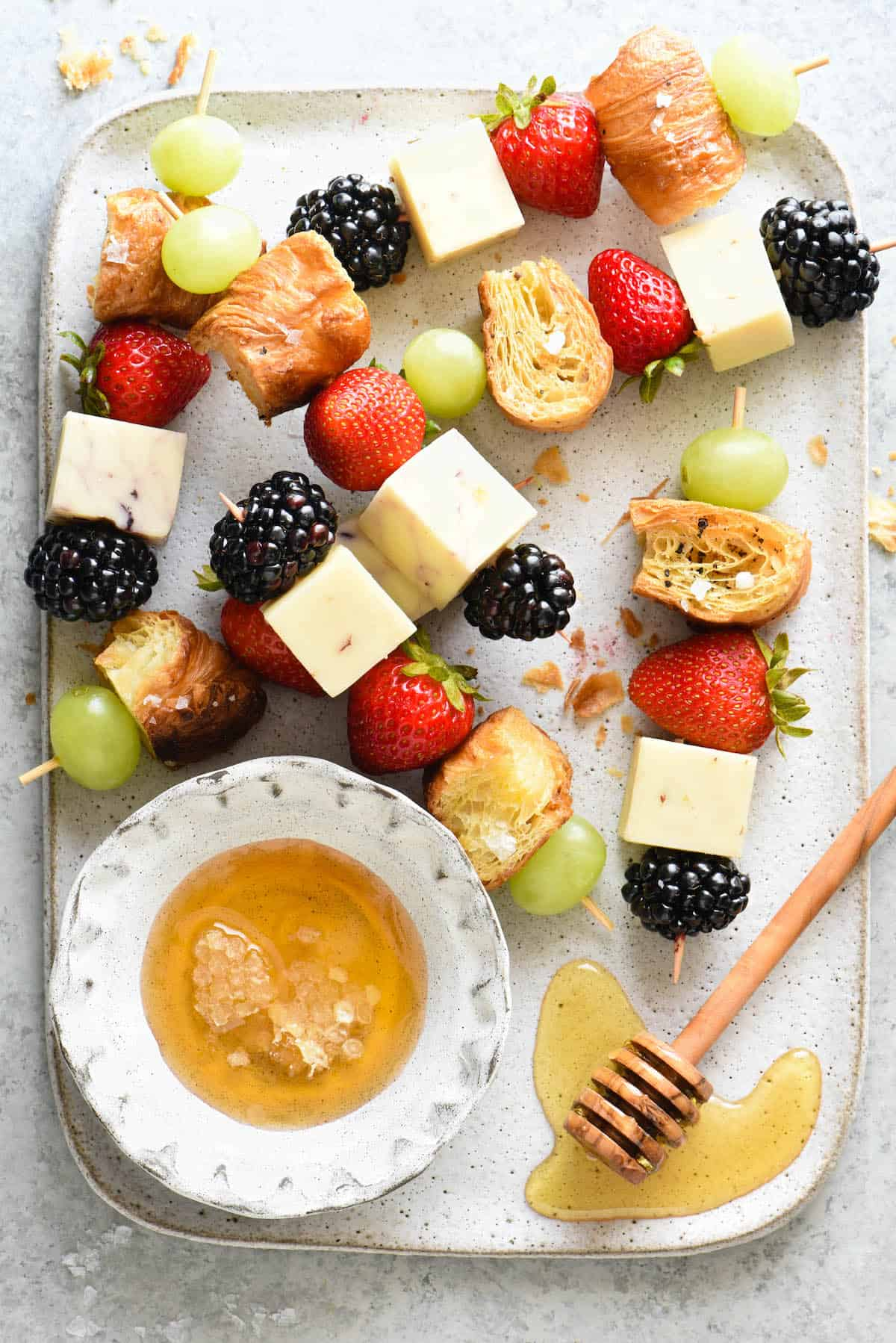 These fresh Fruit and Cheese Kabobs with Croissant Croutons are a nutritious snack that both kids and adults will love. This colorful combination of sweet fruit, savory cheese and flaky croutons comes together in a snap. | foxeslovelemons.com