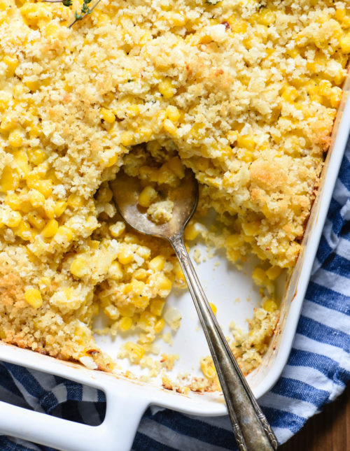This Corn Casserole with Cheese is simple to put together and guaranteed to be a crowd pleaser. You can't beat creamy, cheesy corn topped with buttery breadcrumbs. | foxeslovelemons.com