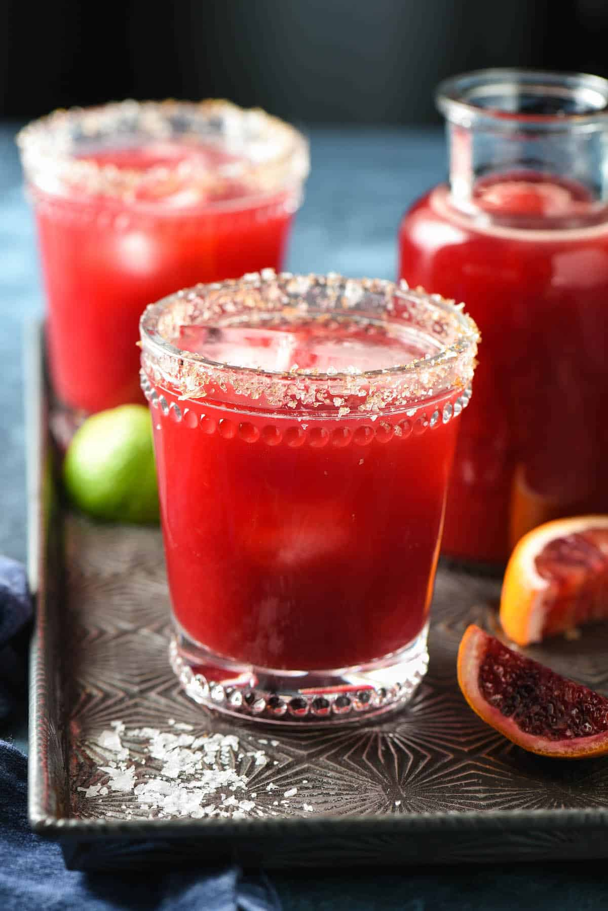 This Blood Orange Margarita recipe is sweetened with honey, and comes together in 5 minutes, with just 4 ingredients. | foxeslovelemons.com