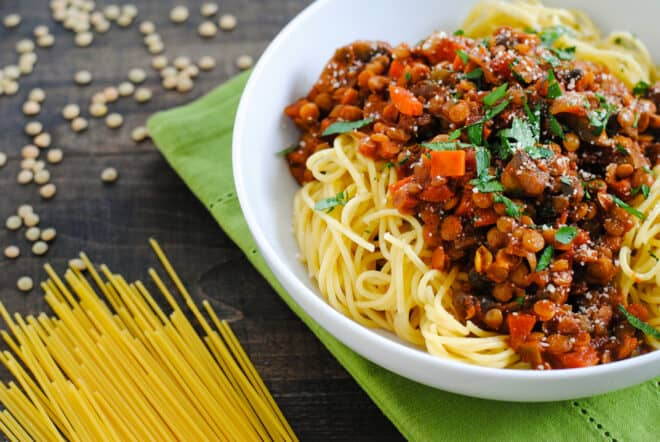 White bowl filled with noodles and vegan pasta sauce.