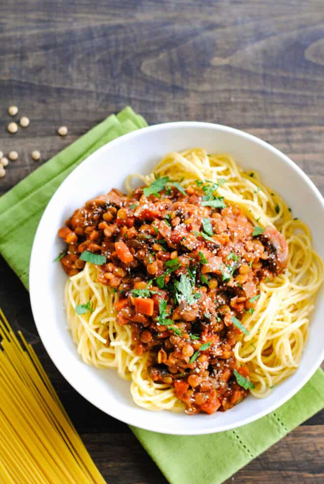 Large white bowl filled with spaghetti and vegan ragu.